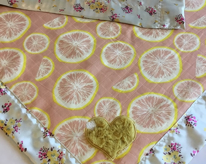 Grapefruit bamboo Muslin front, backed and edged with silky fabric. This is travel size lovey 20x20, Muslin silky