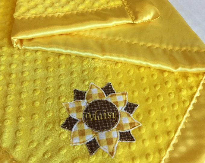 30x40 yellow on yellow with name inside sunflower. Yellow Minky front, backed & edged with yellow silky fabric