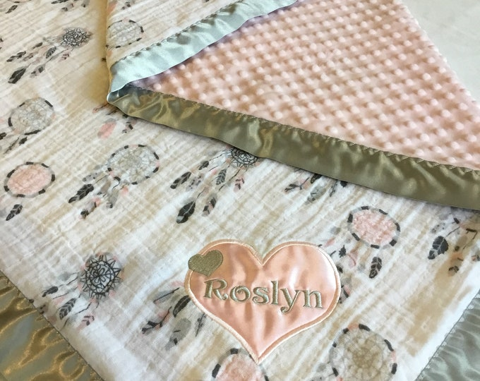Dream Catcher Muslin Baby Blanket. Muslin front backed with pink cozy minky fabric, edged with grey silky binding approx 30x40