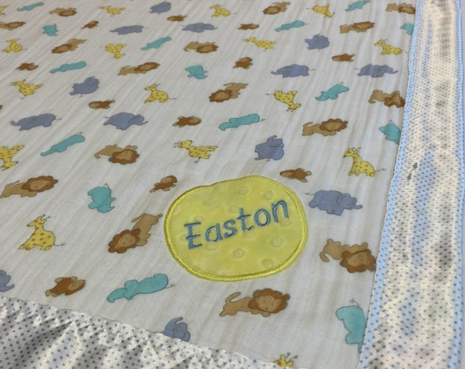 Personalized Baby Blanket Muslin front backed and edged with silky fabric.