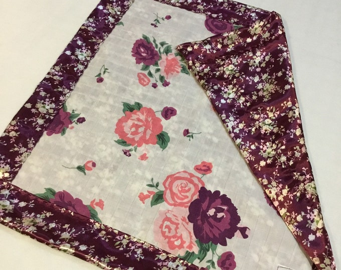 Adorable bamboo floral muslin lovey , floral muslin front, Backed & edged with high Quality silky fabric .. Perfect baby shower gift. 20x20