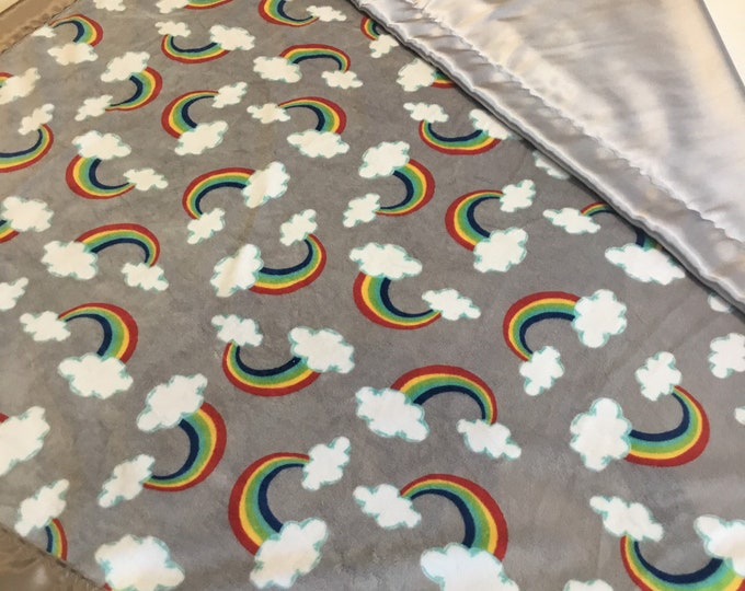 Plush Rainbow blanket, cozy minky Rainbow print front, backed and edged with coordinating silky fabric. This blanket is approximately 40x50