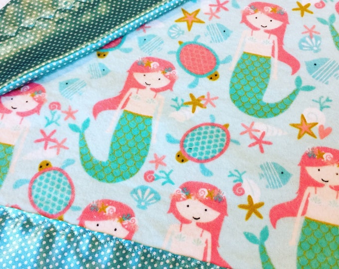 Mermaid baby blanket. Flannel front, backed and edged with silky fabric. This is travel size lovey 20x20. Perfect baby shower gift