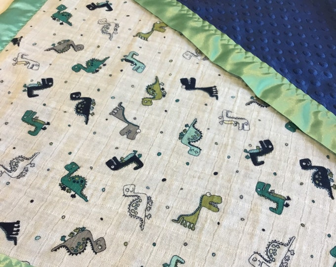 Dinosaur baby blanket, muslin front-backed with plush minky fabric-edgedwith silky fabric 30x35