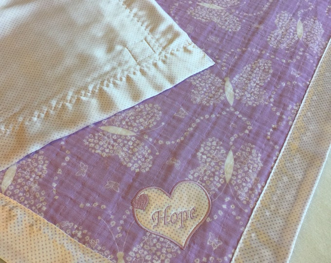 Gorgeous double gauze lavender muslin, backed and edged with coordinating silky fabric