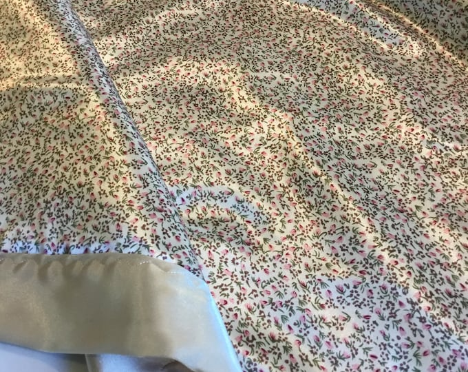 Floral Silky Baby Blanket, measures 30x40, floral silky front/backed and edged with coordinating silky