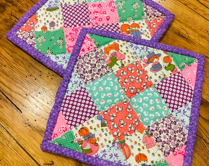 Set of quilted pot holders. These heirloom potholders are approximately 8x8, 1930's  quilt patterns, great Mother's Day gift