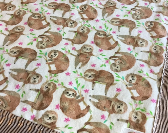 Lovey, baby blanket, crib blanket, silky blanket. Beautiful sloth flannel front, backed and edged with pinstriped charmeuse silky, 20x20
