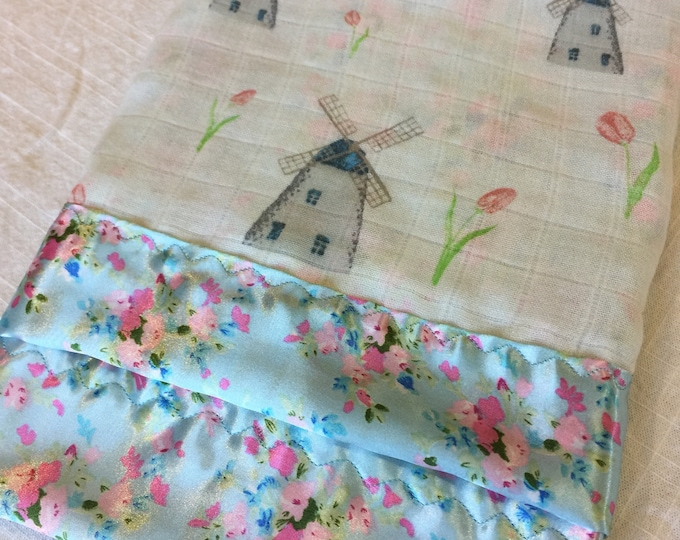 Windmill organic double gauze, backed and edged with silky fabric. This is travel size lovey 20x20. Muslin lovey baby blankie