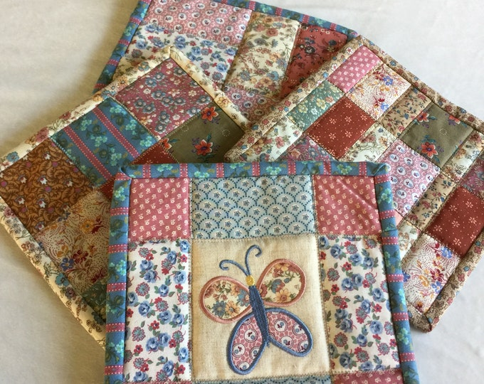 gorgeous homemade butterfly, floral  quilted potholders. Beautiful floral cotton front. Perfect for girt giving snd receiving. 8.00 each