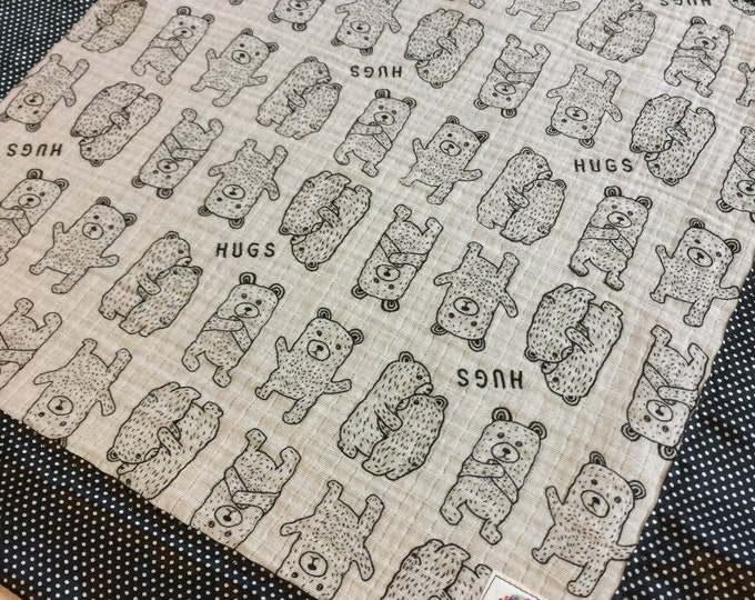 Gorgeous double gauze bear hugs muslin, backed and edged with coordinating black with white pin dot silky fabric 30x40