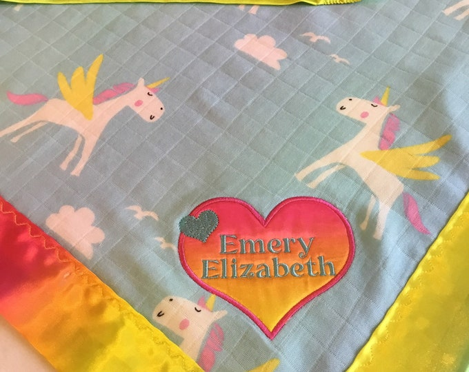 Unicorn bamboo Muslin front, backed and edged with rainbow silky fabric. This is travel size lovey 20x20, Muslin silky