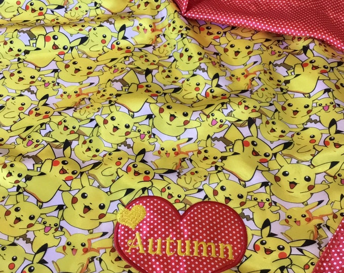 Pokemon Pikachu Silky Blanket...This fun blanket measures approximately 40x50. Silky Pikachu front, backed and edged with Red pindot silky