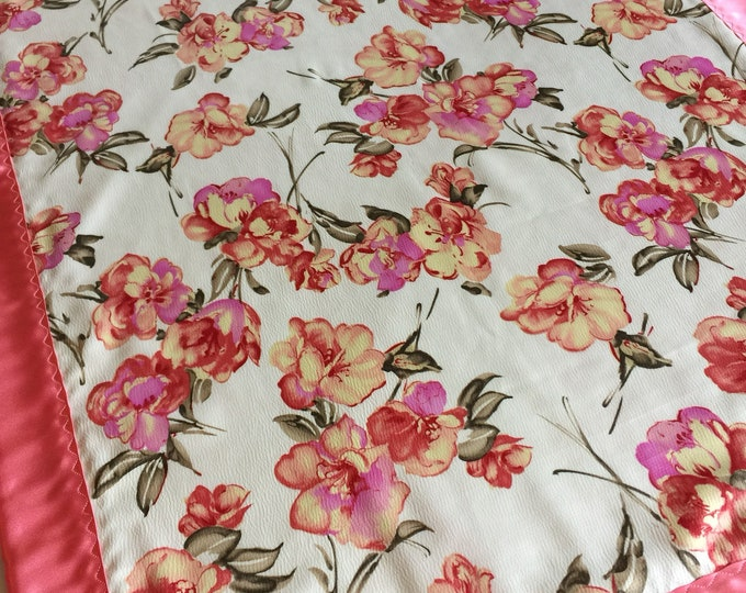 This ia a one of a kind ! Gorgeous floral silky baby blanket, crepe silky front, backed and edged with coral charmeuae silky, perfect gift !