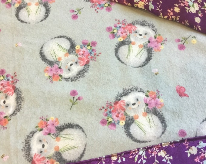 Adorable Hedgehog Silky baby blanket. Hedgehog flannel front backed and edged with silky soft charmeuse satin. Approximately 30x40