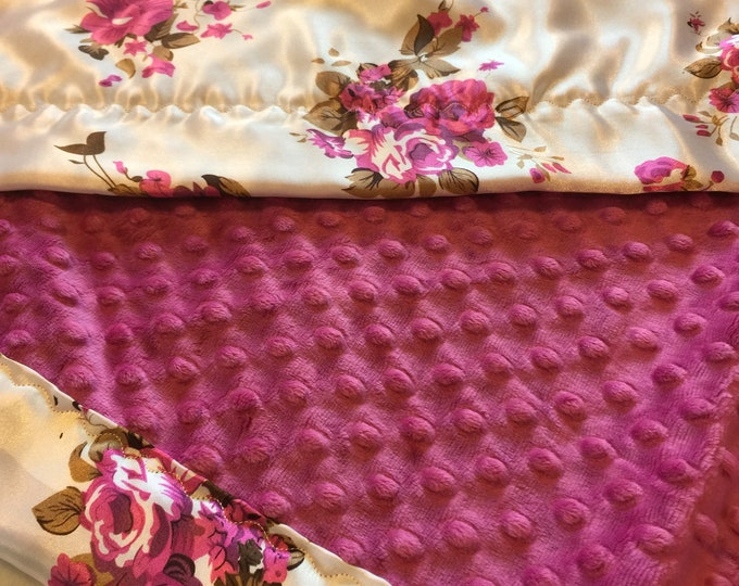 Silky Baby Blanket, raspberry minky front, backed and edged with coordinating floral silky fabric. These blankets can be made 30x40 or 40x50