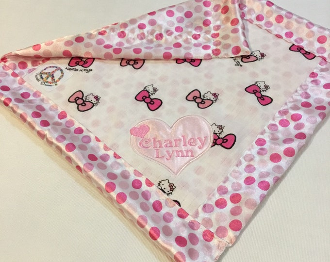 Mini 12X12 Breathable Muslin Lovey, baby blanket. Adorable hello kitty Muslin print, backed and edged with adorable polka dot silky.