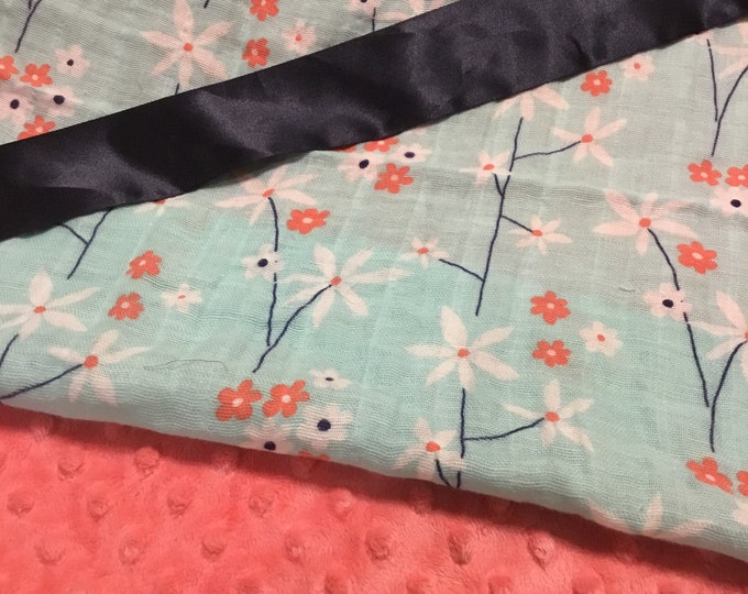 20x20 lovey, floral muslin front, backed with coordinating minky, edged with coordinating satin binding