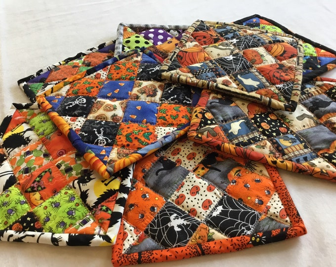 Handcrafted quilted Halloween potholders.. I have made a variety of homemade hand pieced hot pads. Approximately 9x9 with hanging tab