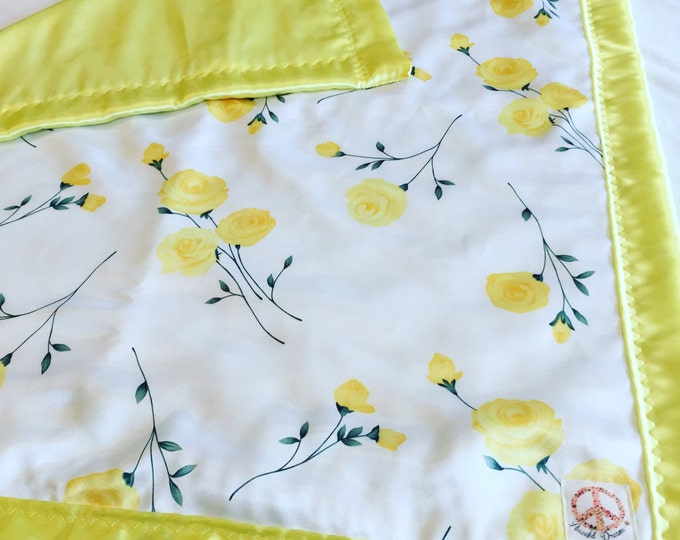 Gorgeous floral silky baby blanket. Beautiful yellow floral silky fabric, backed & edged with high Quality yellow silky fabric. Crib blanket