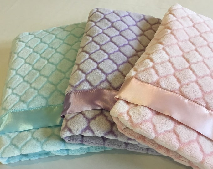 Plush cozy baby blanket ~ edged with silky binding.  Three beautiful colors to choose from. Measures (30x40)