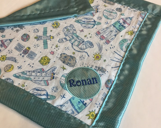 Spaceship Muslin front, backed and edged with coordinating silky fabric. This is travel size lovey 20x20, Muslin silky