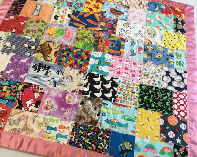 Homemade I spy Quilt, this baby blanket measures approximately 38x38, cozy minky back bordered with satin trim,