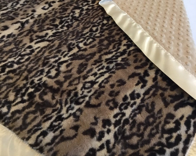 Adorable cheetah plush baby blanket, backed with dimple minky, with a coordinating satin trim