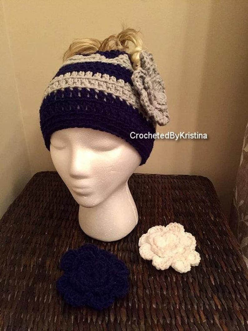 fc131e2cc Crocheted Dallas Cowboys messy bun/pony tail hat with flower applique,  running hat, mom bun hat, hat for ponytail, top knot hat