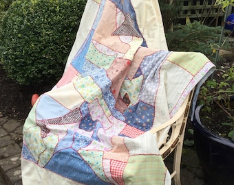 Patchwork quilt, hand sewn and quilted single quilt with feather stitch decoration