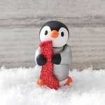 Christmas penguin decoration. Little pottery penguin with a red glittery stocking. One of a kind