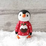 Christmas penguin decoration. Little pottery penguin in a red Christmas pudding jumper. Ceramic Christmas ornament One of a kind.