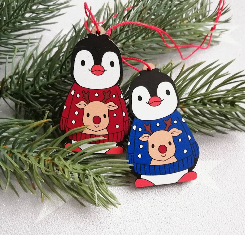 Penguin reindeer jumper decoration. Little wooden penguin image 0