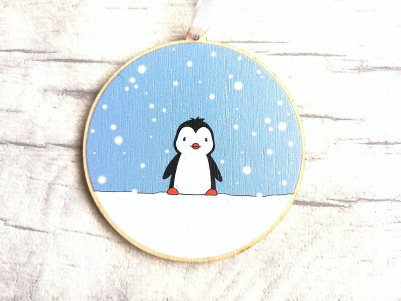 Little wooden penguin decoration. Little penguin in the snow image 0
