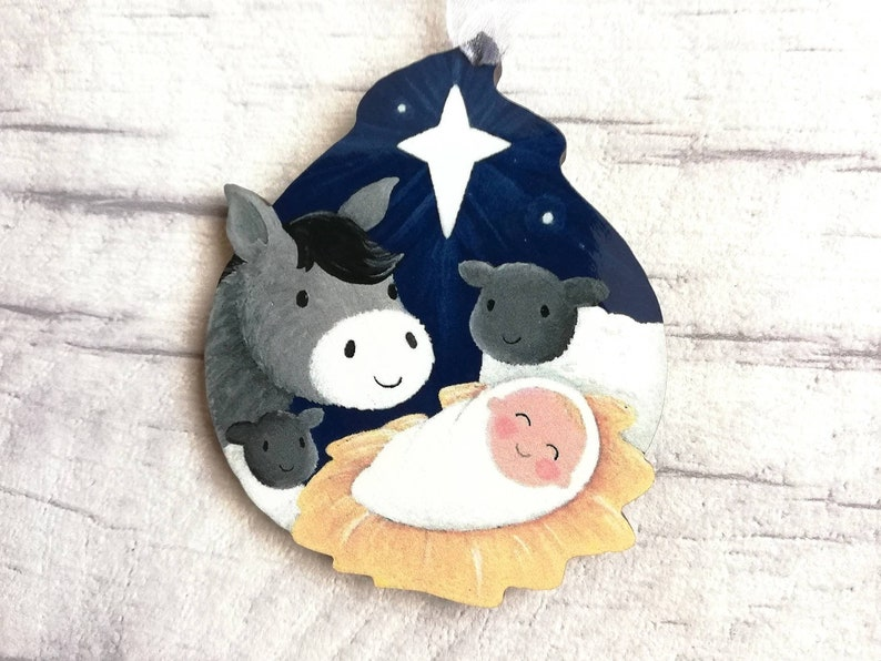 Little wooden nativity decoration. Baby Jesus in the manger image 0