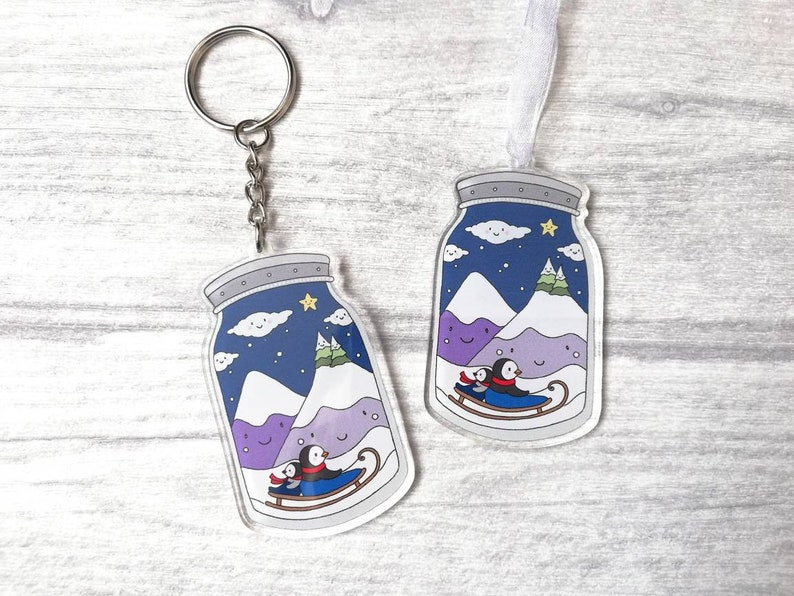 Penguins in a jar keyring or decoration. Cute winter charm image 0