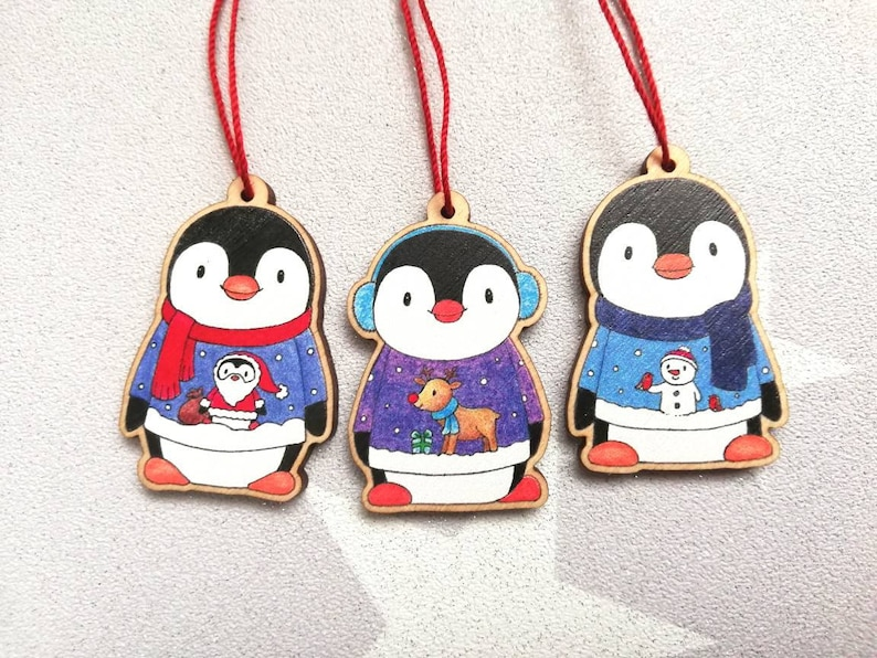 Penguin Christmas decorations. Set of three wooden penguins. image 0