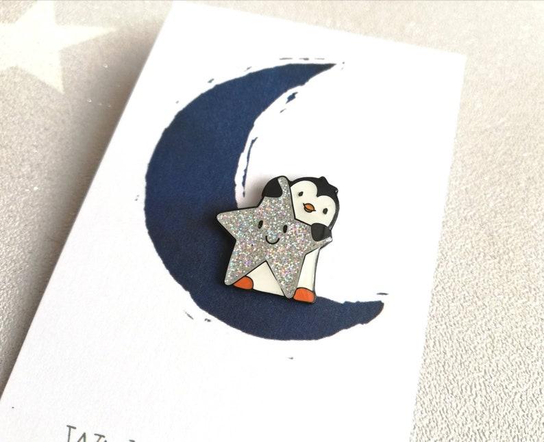 Little penguin and star pin. Penguin glitter enamel pin. image 0