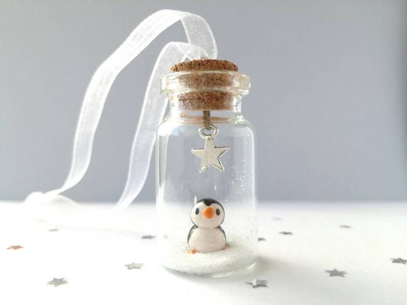 Miniature penguin decoration. Little pottery penguin in a image 0