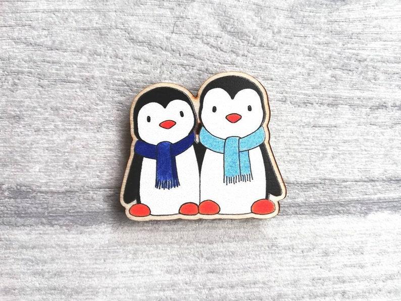 Penguin magnet little wooden penguins in blue scarves fridge image 0