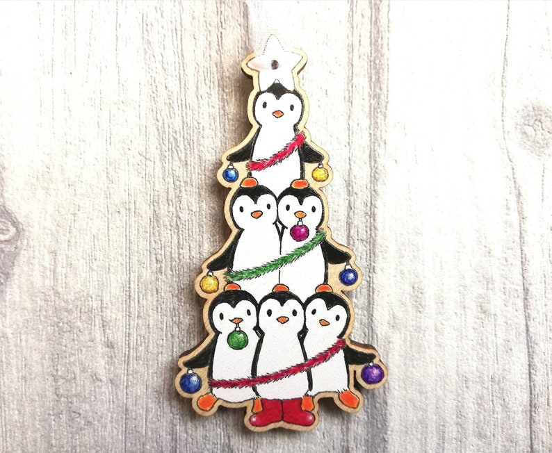 Penguin decoration. Little wooden Christmas tree ornament image 0