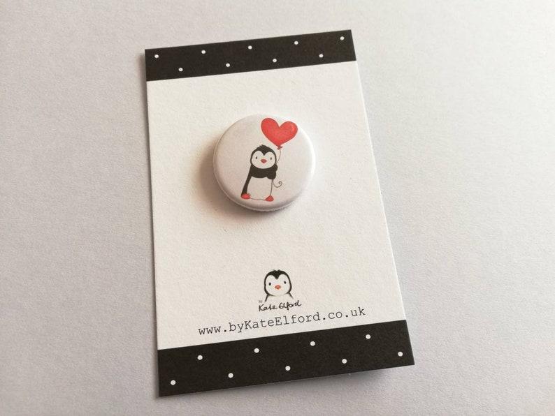 Mini penguin badge little penguin and red heart balloon pin image 0