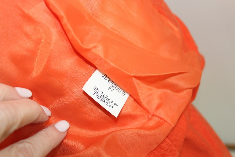 Short sleeved orange skirt set with zippered details US size 4-6 Parisian Woman/'s suit by Orna Forho in French size 38.