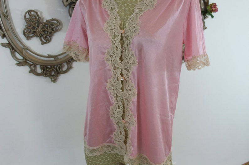 Vintage pink baby doll bed jacket size XS  Nylon with lace.