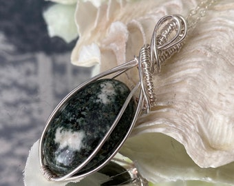 """Preseli Blue Stone Wire Wrapped Pendant - """"Developing psychic gifts linked to the ancients""""."""