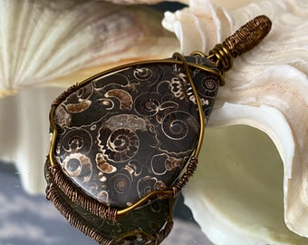Beautiful Polished Fossil Ammonite (United Kingdom 196 million years) Bronze Wire Weave Hand Crafted Pendant.- change and positive motion.