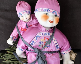 Chinese Composite Dolls - Smiling Parent and Backpack Baby