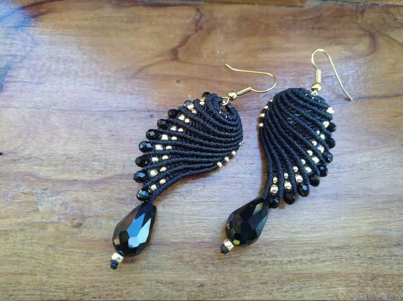 Black and golden macram\u00e8 earrings in wings shape
