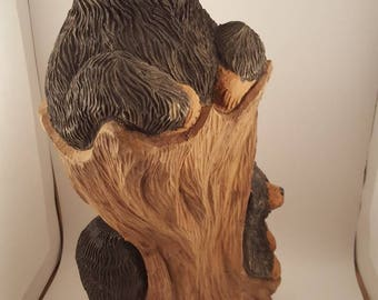 Two bears in a tree stump hand carved from wood