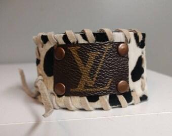 22fe3caae60 Repurposed Louis Vuitton leopard print cowhair bracelet.